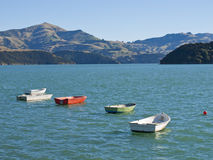 Smal oared boats on a lake in New Zealand Stock Photo