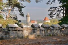 Smal stone wall by road leading around Kokorin castle in Kokorinsko landscape area in autumnal Czech republic Royalty Free Stock Images
