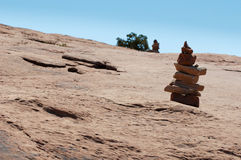 Smal tower made of red sandstone stones. Plateau of red sandstone with lonesome stone tower Royalty Free Stock Photography