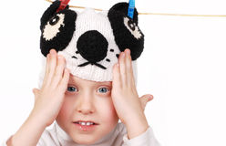 Smaling boy face in funny panda hat Royalty Free Stock Image