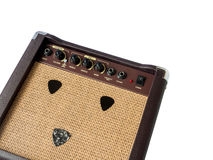 Small acoustic guitar amplifier with pick guitar Royalty Free Stock Photo