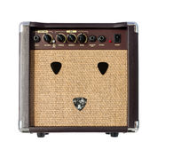 Small acoustic guitar amplifier with pick guitar Royalty Free Stock Images