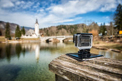Small action camera filming nice landscape slow motion outdoors.  stock photography