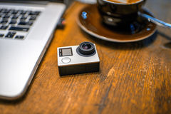Small action video camera on the table Stock Photos