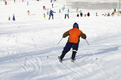Small active child skiing on snow slope Stock Images