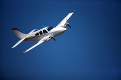 Small aeroplane. Small airplane against blue sky Stock Photos