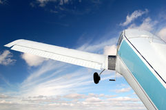 Small aeroplane. Small aircraft flying in the sky with clouds Royalty Free Stock Photo