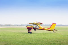 Small aeroplane in the field Royalty Free Stock Photos