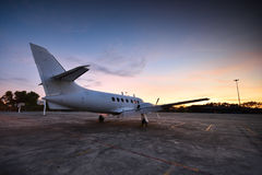 Small aeroplane infront of aircraft hangar Stock Photo
