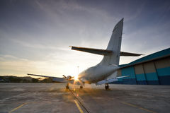 Small aeroplane infront of aircraft hangar Stock Images