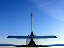 Small Aeroplane in Midair. A closeup of the rear of a small aeroplane in midair Stock Photo