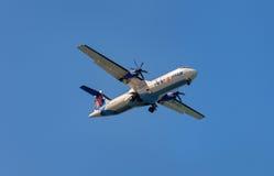 Small aeroplane into sky. Royalty Free Stock Photo