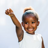 Small African girl pointing with finger into distance. Stock Image