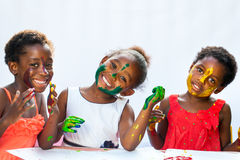 Small African girls showing painted faces Stock Photography