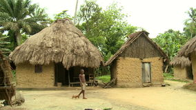 Small african village with grass huts stock video footage