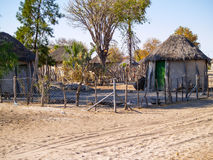 Small African village road, homes and people of Gweta Botswana Royalty Free Stock Image