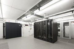 Small air-conditioned  computer server room. Environment with racks Stock Image