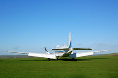 Small Aircraft. Parked in airfield overlooking countryside Stock Image