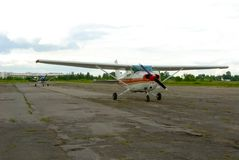 Small aircraft on airfield Royalty Free Stock Photo