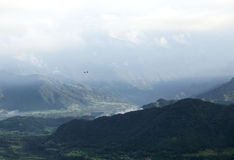 Small aircraft flying in the gorgeous valley of Pokhara Royalty Free Stock Photography