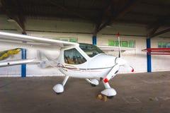 Small aircraft in a hangar Stock Photos