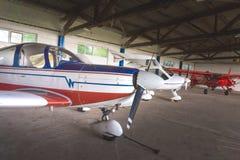 Small aircraft in a hangar Royalty Free Stock Photos