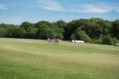 Small aircraft just landing on grass Royalty Free Stock Image