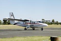 Small Aircraft at Nanyuki airstrip. NANYUKI, KENYA-OCTOBER 18: Small Air Kenya aircraft landing at Nanyuki Airstrip on October 18, 2013, Nanyuki, Laikipia, Kenya Royalty Free Stock Image