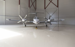Small aircraft parked in a hangar Royalty Free Stock Images