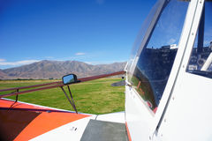Small aircraft on rural airstrip, ready for take-off. Royalty Free Stock Photography