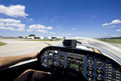 Small aircraft taking off from runway Stock Images
