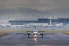 Small Aircraft Taxiing at Airport Royalty Free Stock Images