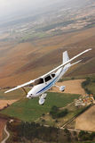 Small airplane. Flying over farm Royalty Free Stock Photo