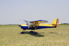 Small airplane. Airplane in an airshow with Romanian flag Stock Photography