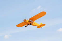 Small airplane. Blue sky and small airplane (flying Royalty Free Stock Photos