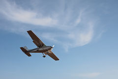 Small airplane. With propeller flying in blue sky Royalty Free Stock Photos