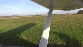 Small airplane aircraft wing on airfield stock video footage