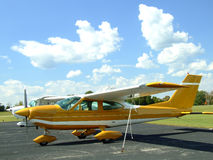 Small Airplane at Airport. Small plane with propeller on sunny summer day Royalty Free Stock Photography