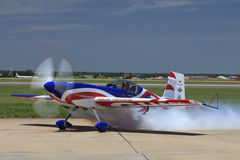 Small airplane blowing out carbon smoke Royalty Free Stock Photos