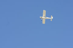 Small airplane in the blue sky Stock Photos