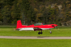 Small airplane doing aerial acrobatics at low altitude Royalty Free Stock Image