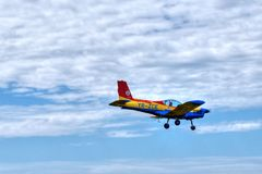 Small airplane flying at acrobatic aero show Stock Image