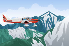 Small Airplane Flying Across the Mountains Stock Image