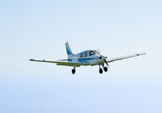 Small airplane flying. Landing or taking off Royalty Free Stock Photography