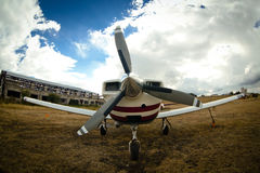 Small airplane on  grass Stock Images