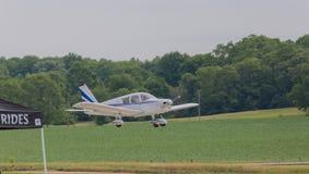 Small Airplane Landing Stock Photo