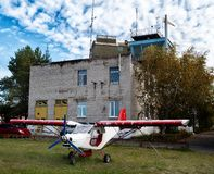 Small airplane in little airport Royalty Free Stock Images