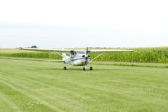 Small Airplane On Field Stock Photo