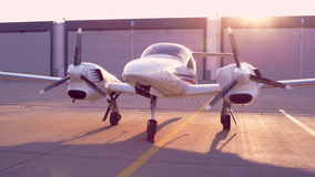 Small airplane parked in airport. Private airplane at airport parking place stock video footage