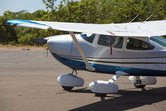 Small airplane parked with forest behind, Canaima, venezuela Stock Images